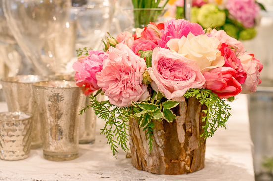"""At this shop that combines """"classic European with a modern twist,"""" garden roses mingle with Dutch ruffled tulips in a birch-lined pot."""