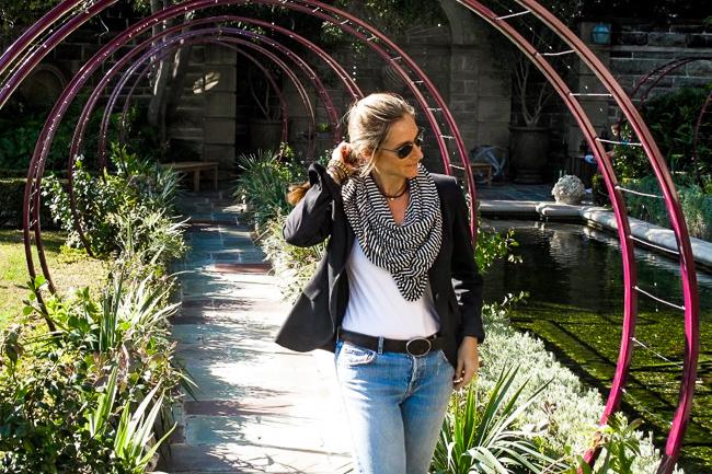 Jennifer Gilbert Asher walks through Gracie Modern Arbor alllée at Greystone Mansion in Beverly Hills. Landscape design by Grace Design Associates.
