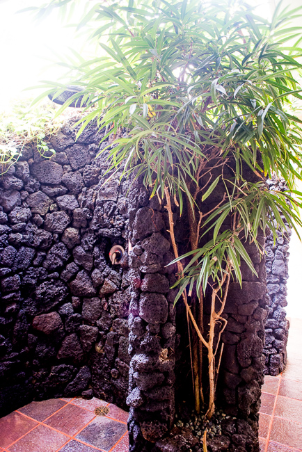 Outdoor showers in the resort spa. Lava rock and palms provide privacy.