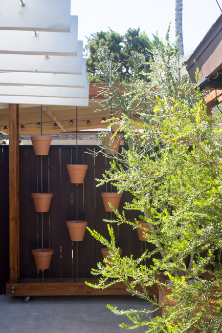 Vertical clay pot garden. DIY by The Horticult / Ryan Benoit Design