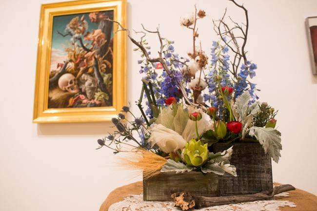"Sandy Villa AIFD, CFD of Mission Hills Florist - Floral Interpretation of ""After Many Days"" by Thomas Hart Benton."