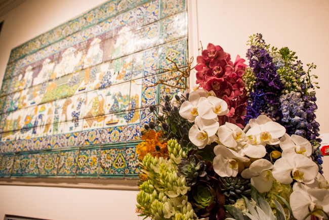 """Katherine Brozowski of Wild Orchid Florist — floral interpretation of """"Court scene with dancing and feasting."""""""